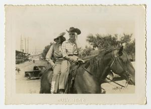 Primary view of object titled '[Two Women Stroll by on Their Horse]'.