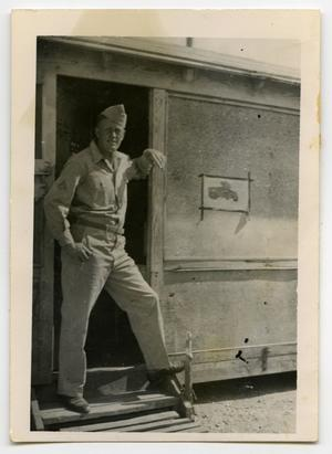 Primary view of object titled '[Photograph of Harold Wells in Hut]'.