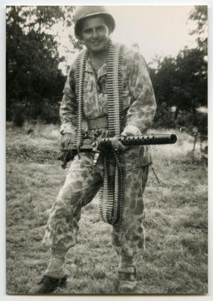 "Primary view of object titled '[Photograph of Emil ""Broc"" Boracchia with a Machine Gun]'."