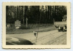 Primary view of object titled '[Photograph of Vehicles on Dirt Road]'.