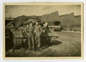Primary view of object titled '[Two Soldiers Standing in Front of a Tank]'.