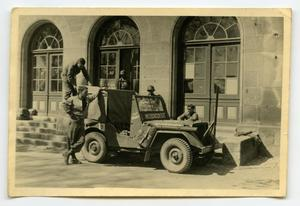 Primary view of object titled '[Photograph of Soldiers and Jeep]'.