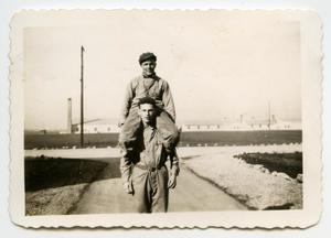 Primary view of object titled '[Photograph of Two Soldiers near Camp]'.