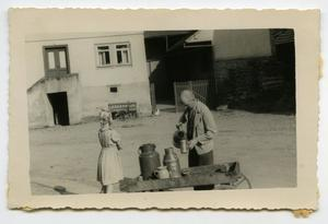 Primary view of object titled '[A Milk Vendor Selling His Milk to a Girl]'.