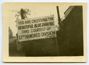 Primary view of object titled '[Photograph of Crossing Danube Sign]'.