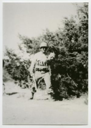 Primary view of object titled '[Photograph of a Soldier near Bushes]'.