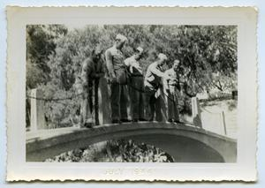 Primary view of object titled '[A Group of Soldiers Stands Over a Small Bridge]'.