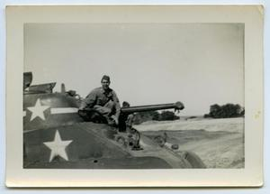 Primary view of object titled '[Smiling Soldier Sitting on a Tank]'.