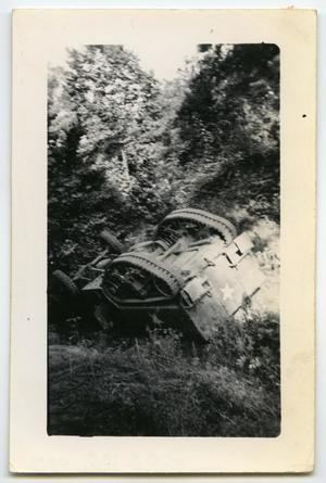 Primary view of object titled '[Photograph of Upside Down Half-Track]'.