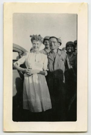 Primary view of object titled '[Photograph of Anita Louise with Soldiers]'.
