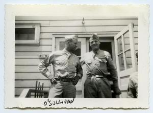 Primary view of object titled '[Photograph of Two Soldiers at a Cabin]'.
