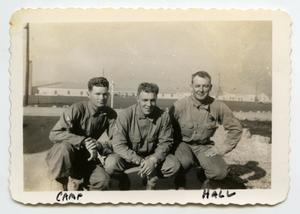 Primary view of object titled '[Photograph of Three Soldiers near Camp]'.