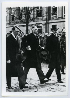 Primary view of object titled '[Adolf Hitler Walking with Two Men]'.