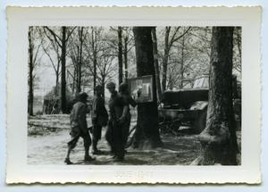 Primary view of object titled '[Troops Check the Bulletin Board]'.
