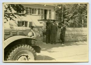 Primary view of object titled '[Photograph of Soldiers Outside House]'.
