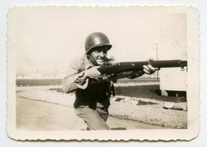 Primary view of object titled '[Photograph of a Soldier with a Rifle]'.