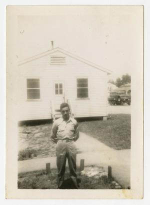 Primary view of object titled '[Joe Reed Near White Building]'.