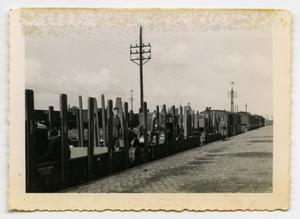 Primary view of object titled '[German Soldiers Sitting on Flatbed Rail Cars]'.
