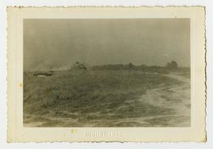 Primary view of object titled '[A Tank Rolls Down a Dirt Path]'.