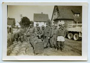 Primary view of object titled '[Nine Soldiers Huddle for a Picture]'.
