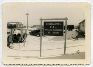 Primary view of object titled '[Photograph of 134th Ordinance Maintenenace Battalion Headquaters at Camp Barkeley]'.