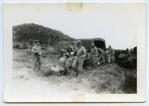 Primary view of object titled '[Photograph of a Chow Line in a Field]'.
