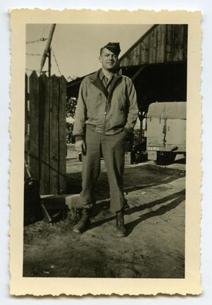 Primary view of object titled '[A Soldier Standing by a Fence]'.