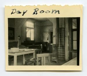 Primary view of object titled '[Looking at a Day Room in Germany]'.