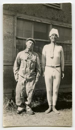 Primary view of object titled '[Two Soldiers Standing Behind a Building]'.