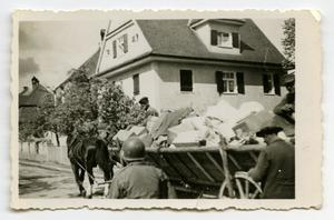 Primary view of [Civilians Hauling Boxes by Wagon]