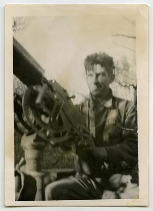 Primary view of object titled '[Photograph of Soldier at Machine Gun]'.