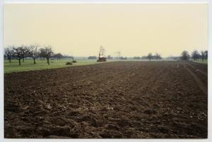 Primary view of object titled '[Overlooking a Field Near Herrlisheim, France]'.