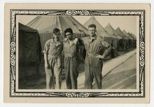 Primary view of object titled '[Three Men Behind Row of Tents]'.