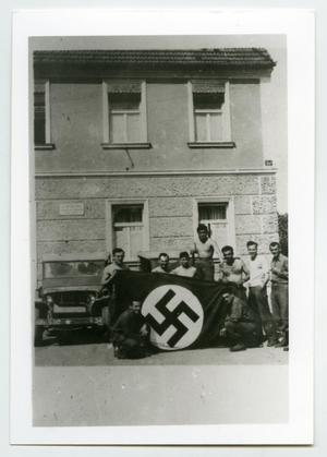 Primary view of object titled '[A Group of Soldiers Standing Behind a German National Flag]'.