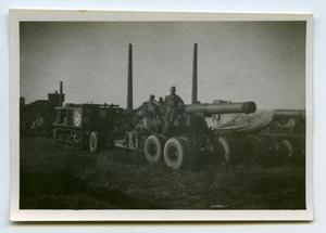 Primary view of object titled '[A Soldier Standing on a Large Howitzer]'.
