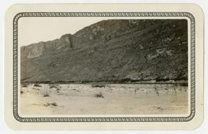 Primary view of object titled '[Photograph of a Large Rock Cliff Near Johnson's Ranch]'.