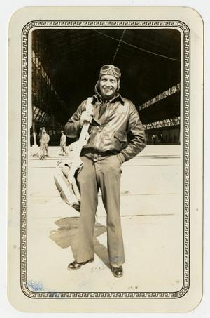 Primary view of object titled '[Photograph of Al Palmer Standing in Front of a Hangar at Brooks Field, Texas]'.