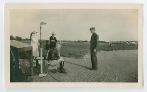 Primary view of object titled '[Photograph of a Pilot Reporting to his Instructor]'.