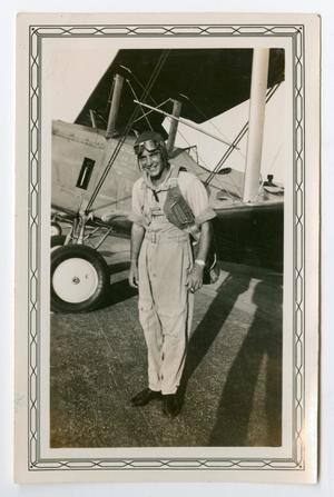 Primary view of object titled '[Photograph of Arthur J. Pierce by an Airplane]'.