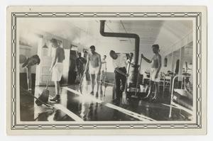 Primary view of object titled '[Photograph of Cadets Cleaning the Barracks at Kelly Field]'.
