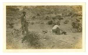 Primary view of object titled '[Photograph of Two Men Making Dinner in the Mountains]'.