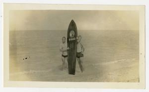 Primary view of object titled '[Photograph of Bill and Bud with a Surfboard at Bayside, Texas]'.