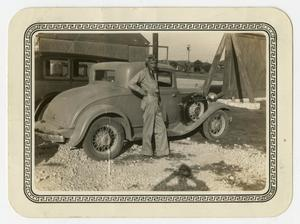 Primary view of object titled '[Photograph of George E. Pierce by a Car]'.