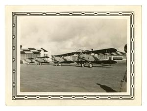 Primary view of object titled '[Photograph of a Line of BT-2B Planes at B-Stage]'.