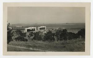 Primary view of object titled '[Photograph of the 88th Hangar with Planes at Hamilton Field, California]'.