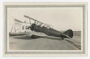Primary view of object titled '[Photograph of a Cadet in an Airplane at Kelly Field]'.