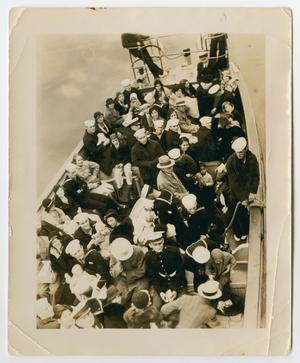 Primary view of object titled '[Photograph of Sailors and Families on a Small Boat]'.