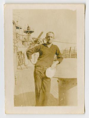 Primary view of object titled '[Photograph of a Sailor on the Deck of the U.S.S. Texas]'.