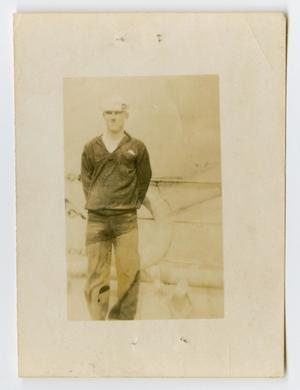 Primary view of object titled '[Photograph of a Sailor on the Edge of the U.S.S. Texas]'.