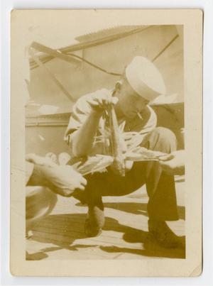 Primary view of object titled '[Photograph of a Sailor Smoking a Cigarette]'.